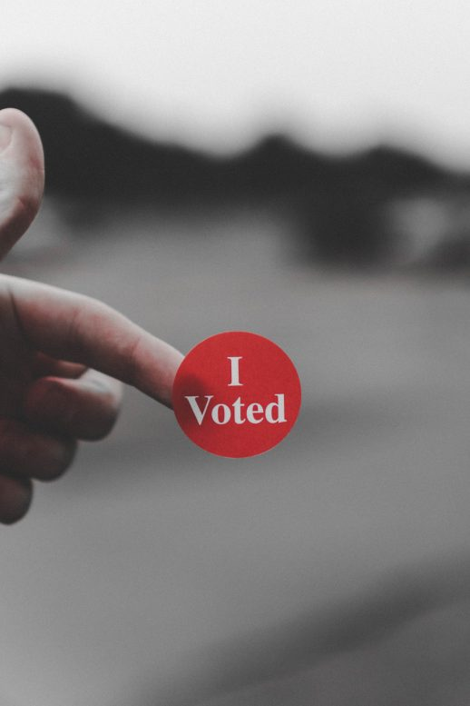 "Finger with ""I voted"" sticker"